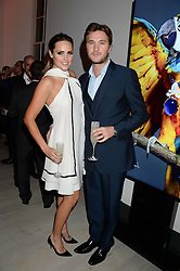 BEN & ELLE CARING at a party to launch the Autumn/Winter 2013 Candy Magazine held at The Saatchi Gallery, Duke of York's HQ, King's Road, London on 15th October 2013.