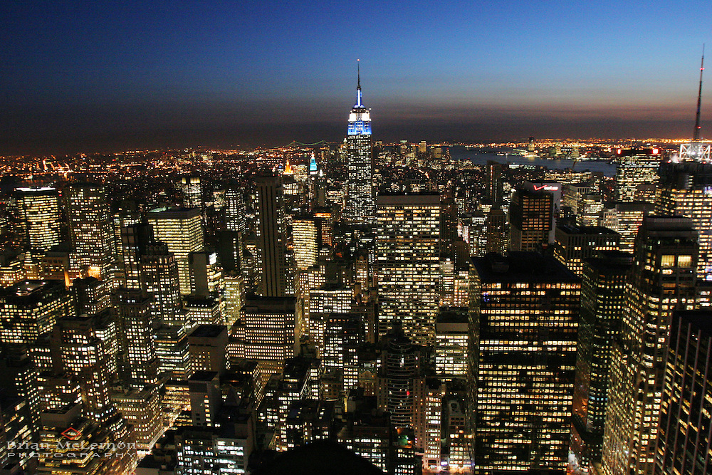 Empire State Building and Lights of New York City at night from Rockefeller Center