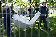 Bailiffs carry away mattresses after evicting housing activists from properties on the Sweets Way housing estate on 23rd September 2015 in London, United Kingdom. A group of housing activists calling for better social housing provision in London had occupied some of the properties on the 142-home estate in Whetstone, in some cases refurbishing properties intentionally destroyed by the legal owners following eviction of the original residents, in order to try to prevent the eviction of the last resident on the estate and the planned demolition and redevelopment of the entire estate by Barnet Council and Annington Property Ltd.