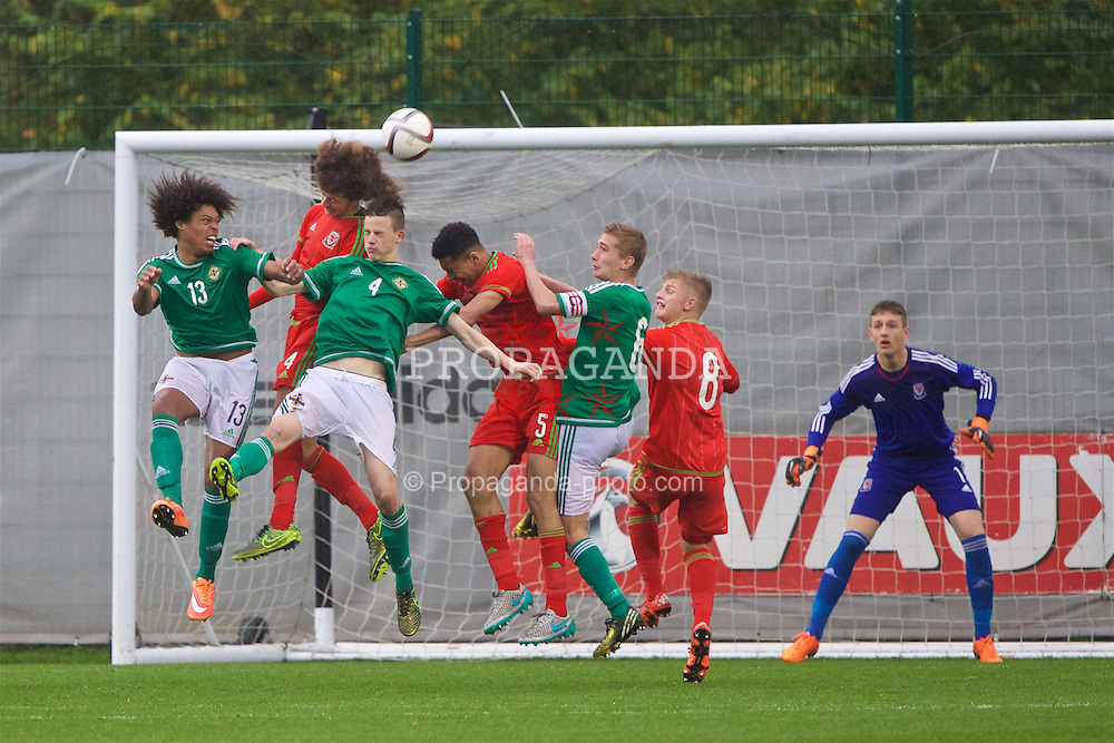 NEWPORT, WALES - Thursday, November 5, 2015: Wales' captain Ethan Ampadu in action against Northern Ireland's Leo Brown and Ian Maxwell during the Under-16's Victory Shield International match at Dragon Park. (Pic by David Rawcliffe/Propaganda)