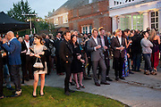 Ewan McGregor; Eve Mavrakis LISTENING TO THE BAND, The Summer party 2011 co-hosted by Burberry. The Summer pavilion designed by Peter Zumthor. Serpentine Gallery. Kensington Gardens. London. 28 June 2011. <br /> <br />  , -DO NOT ARCHIVE-© Copyright Photograph by Dafydd Jones. 248 Clapham Rd. London SW9 0PZ. Tel 0207 820 0771. www.dafjones.com.