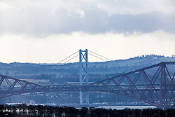 Forth Rail and Road Bridges, as seen from the A921 near Burntisland, Fife.