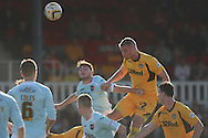 Harry Worley of Newport goes close with a header at goal. Skybet football league two match, Newport county v Exeter city at Rodney Parade in Newport, South Wales on Sunday 16th March 2014.<br /> pic by Mark Hawkins, Andrew Orchard sports photography.