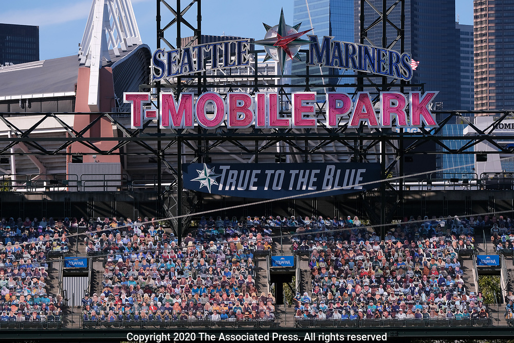 Cutout fans are seen in the stands of T-Mobile Park before a baseball game between the Seattle Mariners and the Texas Rangers, Saturday, Aug. 22, 2020, in Seattle. (AP Photo/John Froschauer)