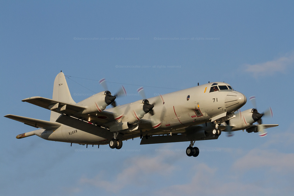 Lockheed P-3C Orion Maritime reconnaissance aircraft with the Japanese Maritime Self Defence Force (JSDF) flying near Atsugi Naval Air Facility, Yamato, Kanagawa, Japan. Friday December 21st 2018
