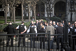 © Licensed to London News Pictures. 22/03/2018. London, UK. Emotional members of the Police Force hold a minutes silence at New Palace Yard, inside the grounds of the Houses of Parliament in Westminster, London at the time PC Palmer died, on the one year anniversary of the Westminster Bridge Terror attack. A lone terrorist killed 5 people and injured several more, in an attack using a car and a knife. The attacker, 52-year-old Briton Khalid Masood, managed to gain entry to the grounds of the Houses of Parliament and killed police officer Keith Palmer. Photo credit: Ben Cawthra/LNP