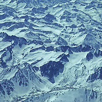The Palisade Crest of California's Sierra Nevada divides this picture horizonally, with the Palisade Glacier(s) below it in the foreground.  L to R: Middle Palisade/Clyde Peak, Mount Sill is near the center, with North Palisade, Thunderbolt Peak and Mount Winchell right of it.  Temple Crag dominates the foreground.