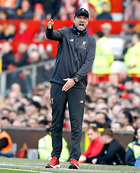 Liverpool manager Jurgen Klopp (centre) reacts on the touchline during the Premier League match at Old Trafford, Manchester.