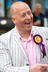 © Licensed to London News Pictures.  30/04/2015. AYLESBURY, UK. Chris Adams, UKIP candidate for Aylesbury, talks to a supporter ahead of a visit by party leader Nigel Farage (not seen).  Photo credit: Cliff Hide/LNP