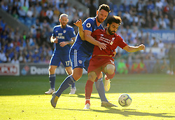 Sean Morrison of Cardiff City jostles with Mohamed Salah of Liverpool- Mandatory by-line: Nizaam Jones/JMP - 21/04/2019 -  FOOTBALL - Cardiff City Stadium - Cardiff, Wales -  Cardiff City v Liverpool - Premier League