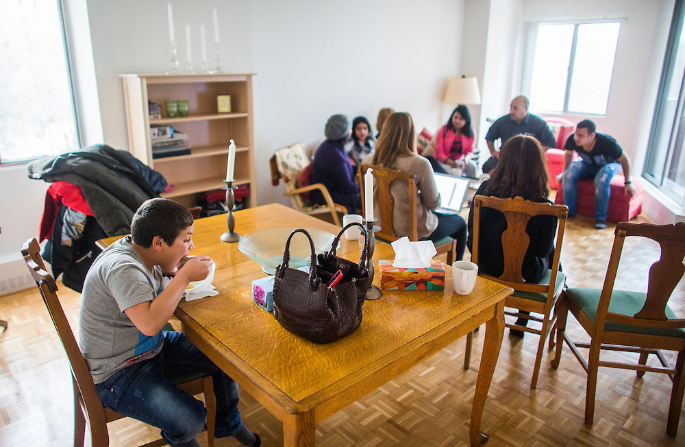 Syrian refugee Nasimi Batal Al Hasan is eats at the table inside their apartment in Mississauga, Ontario, Canada, Thursday January 21, 2016.   (Mark Blinch for the BBC)