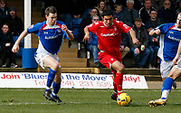 Jack Lester of Nottingham Forest (right) attacks the Chesterfield defence