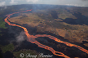 Aerial view of Kilauea Volcano east rift zone erupting hot lava from Fissure 8 in the Leilani Estates subdivision near the town of Pahoa. The lava drains downhill as an incandescent river through Kapoho to the ocean, where clouds of acidic steam are emitted at the ocean entry, Puna District, Hawaii Island ( the Big Island ), Hawaiian Islands, U.S.A.