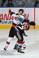 KELOWNA, CANADA, OCTOBER 11: Cole Grbavac #14 of the Medicine Hat Tigers gets in the face of Jessey Astles #27 of the Kelowna Rockets as the Medicine Hat Tigers visited the Kelowna Rockets on October 11, 2011 at Prospera Place in Kelowna, British Columbia, Canada (Photo by Marissa Baecker/shootthebreeze.ca) *** Local Caption ***Cole Grbavac;Jessey Astles;