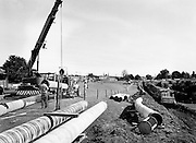 One of the final sections of the Kinsale–Dublin gas pipeline being installed. This section runs along the bank of the Grand Canal at Inchicore, Dublin.<br /> 16 August 1982