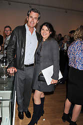 RUPERT EVERETT and GERALDINE HARMSWORTH at a private view of work by the late Rory McEwen - The Colours of Reality, held at the Shirley Sherwood Gallery, Kew Gardens, London on 20th May 2013.