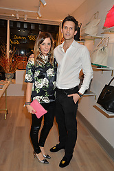 MELISSA DEL BONO and her husband DOUG KER at a party hosted by Melissa Del Bono to celebrate the launch of her Meli Melo flagship store at 324 Portobello Road, London W10 on 28th November 2013.