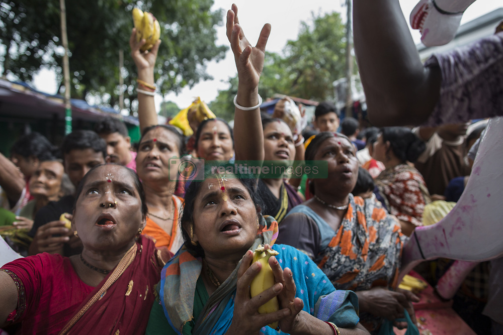 July 3, 2017 - Dhaka, Bangladesh - Bangladeshi Hindu devotees participate in the Rath Yatra, or Chariot procession in Gazipur, Dhaka. The annual Hindu procession commemorates a journey by the Hindu god Jagannath, his brother Balabhadra and sister Subhadra, and sees devotees pulling floats symbolising the chariot used. (Credit Image: © Probal Rashid via ZUMA Wire)