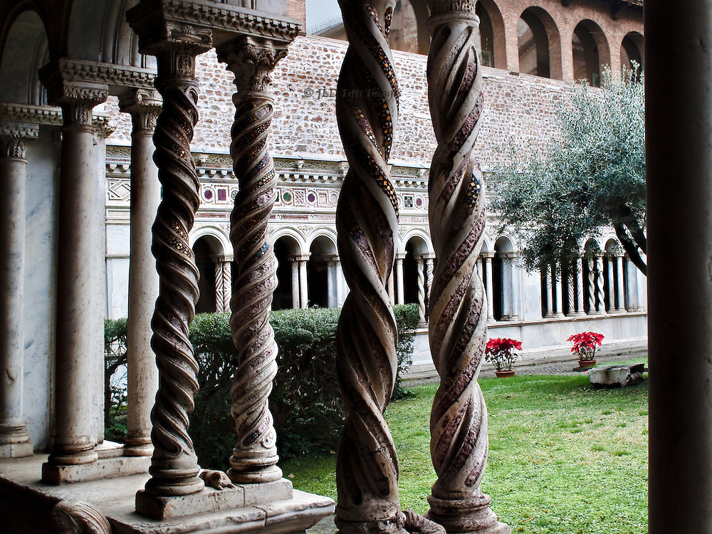 Cloister, San Giovanni in Laterano; details of twisted columns with Cosmati mosaics