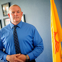 090814       Adron Gardner<br /> <br /> Craig Vandiver the new Grants Chief of Police poses for a portrait during his first day on the job at the Grants Police Department Monday.