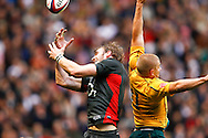 Tom Croft (L) of England clashes with Drew Mitchell of Australia during the Investec series international between England and Australia at Twickenham, London, on Saturday 13th November 2010. (Photo by Andrew Tobin/SLIK images)