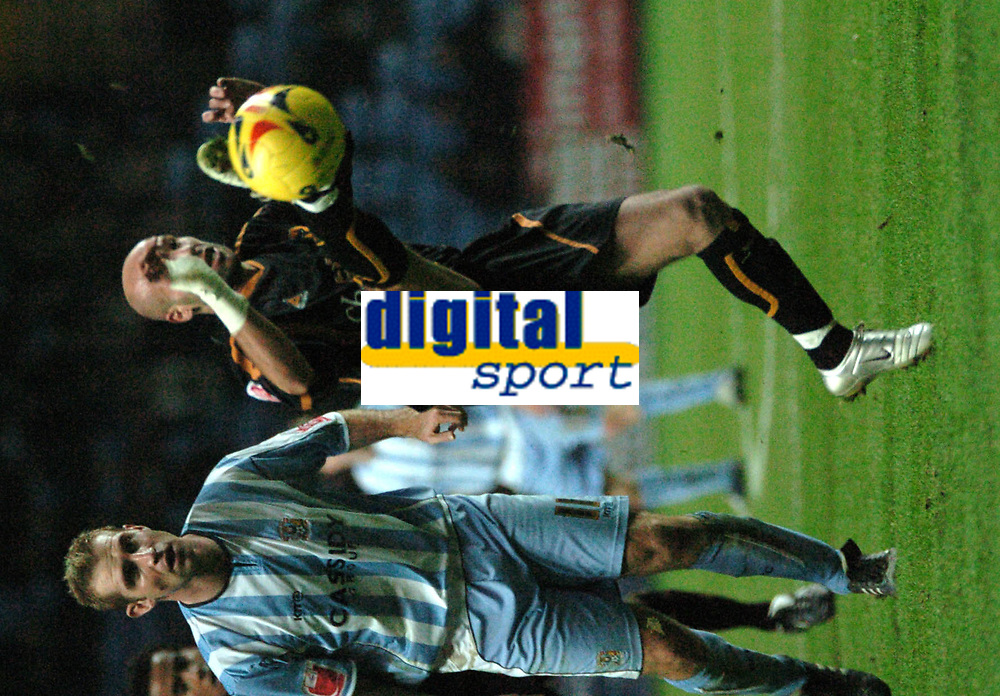 Photo: Ian Hebden.<br />Coventry City v Wolverhampton Wanderers. Coca Cola Championship. 02/01/2006.<br />Wolves Sub Rosa (R) controls the ball in front of James Scrowcroft.