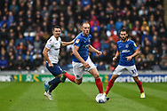 Portsmouth Defender, Matt Clarke (5) runs with the ball during the EFL Sky Bet League 1 match between Portsmouth and Wycombe Wanderers at Fratton Park, Portsmouth, England on 22 September 2018.