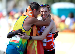 Australia's Dane Bird-Smith (gold) England's Tom Bosworth (silver) and Kenya's Samuel Ireri Gathimba (bronze) congratulate each other at the end of the Men's 20km Race Walk Final at Currumbin Beachfront during day four of the 2018 Commonwealth Games in the Gold Coast, Australia.