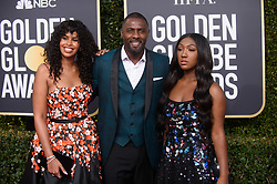 Sabrina Dhowr, Golden Globe presenter Idris Elba and  Miss Golden Globe Isan Elba attend the 76th Annual Golden Globe Awards at the Beverly Hilton in Beverly Hills, CA on Sunday, January 6, 2019.