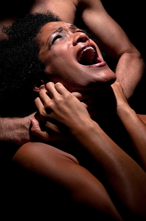 Young hispanic woman being choked and abused.