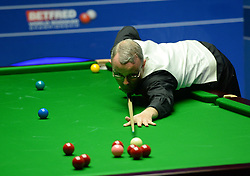 Martin Gould at the table in his match against John Higgins on day four of the Betfred Snooker World Championships at the Crucible Theatre, Sheffield.