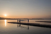 Varese. Lombardia. ITALY. General View.  Sun Set, Crewsreturning from afternoon Training on Lake/Lago Varies. [Varese Rowing Club]. [Canottieri Varese]<br /> <br /> Tuesday  03/01/2017<br /> <br /> [Mandatory Credit; Peter Spurrier/Intersport-images]<br /> <br /> <br /> LEICA CAMERA AG - LEICA Q (Typ 116) - 1/2500 - f4 , Atmospheric, mist, fog, Sunrise, Sunset, Blue Hour,