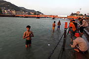 India, Uttarakhand, Haridwar. The Kumbh Mela Pilgrimage. Pilgrims bathing in the Ganges River