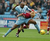 Photo: Ed Godden.<br />Coventry City v Brighton & Hove Albion. Coca Cola Championship. 04/02/2006. <br />Dele Adebola (L) tussles with Brighton's Paul McShane.