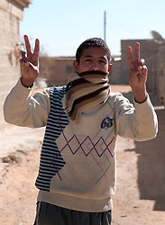 © under license to London News Pictures. 23/02/2011. A Libyan boy shows the peace sign in a small village near the Libyan border with Egypt.  Photo credit should read Michael Graae/London News Pictures