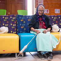 Annie A. James from Standing Rock spinning churro wool at Fiber Spin-Off, Friday, Feb. 15 sponsored by Diné be' iiná and hosted by Lois Becenti and Navajo Technical University in Crownpoint.