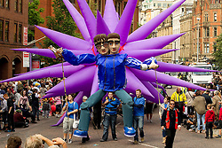 © licensed to London News Pictures. Manchester, UK  19/06/2011. Thousands of Mancunians line the streets of Manchester City Centre to watch the annual Manchester Day Parade, which celebrates Manchester life and culture. Amongst the floats, giant characatures of Manchester musical legends Liam & Noel Gallagher, Heather Small and Morrissey. Please see special instructions for usage rates. Photo credit should read Joel Goodman/LNP