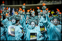 April 27, 2017 - London, United Kingdom - Amnesty Protest 100 Days of Trump...One hundred human rights activists from Amnesty International dressed as the Statue of Liberty protest outside the US Embassy in London's Grosvenor Square. The protest is set to mark 100 days of Trump's presidency of the United States of America.  (Credit Image: © Pete Maclaine/i-Images via ZUMA Press)