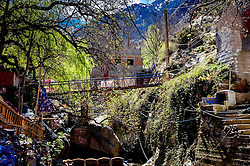A footbridge over the Ourika River in the village of Setti-Fatma in the foothills of the Atlas Mountains in the Ourika Valley, Morocco, North Africa<br /> <br /> (c) Andrew Wilson | Edinburgh Elite media