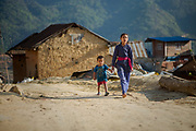 Children walk through a village currently being reconstructed after being almost completely destroyed during the 2015 earthquake, Okharpauwa, Nuwakot District, Nepal