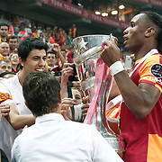 Galatasaray's Didier Drogba celebrate with the trophy after their Turkish Super League soccer match against Trabzonspor at Turk Telekom Arena stadium May 18, 2013.Galatasaray won the Turkish league title for the 19th time. Photo by TURKPIX