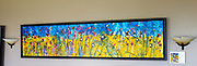 """'Happy, Joyous & Free' . 118"""" x 25"""" .  Acrylic and Ink on Hand Stretched Canvas & Custom Crafted Frame, Created Exclusively for this Painting by Master Craftsman, John Henderson, of Whidbey Island.<br /> <br /> 'HAPPY, JOYOUS & FREE!'<br /> <br /> This painting was created on a fine Whidbey Island summer morning.  The studio doors were wide open, birds chirping away, and I happened to be in an upbeat mood. All the right ingredients for a great painting! I lugged out a roll of canvas, unfurled it to the ground, cut off a chunk around 15 feet long and dropped down into blissful day of creativity, resulting in the beginnings of 'Happy, Joyous and Free.'<br /> <br /> As with most of my paintings, the first day was 'intuitive' and fast-paced, almost like floating in a subconscious state of focused contentment.  Over the course of the next couple days the process became more painstaking as I added the details that brought Happy, Joyous & Free together.<br /> <br /> This painting is different than many of my works as I used rich, deep earth tones as opposed to my usual BOLD. I've added dozens of very thin layers of almost invisible color to build up a translucent 'glow.' This process is referred to as glazing. Each layer not only adds a richness of color but the thin clear glaze, with each layer, adds glass-like refraction reflecting light, causing a subtle glow."""