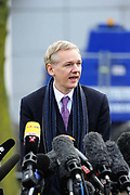 "WikiLeaks founder Julian Assange speaks after his extradition hearing at Belmarsh Magistrates' Court in London February 11, 2011. A lawyer for Assange accused Sweden's prime minister on Friday of damaging his client's chances of a fair trial for alleged sex crimes by portraying him as ""public enemy number one""."