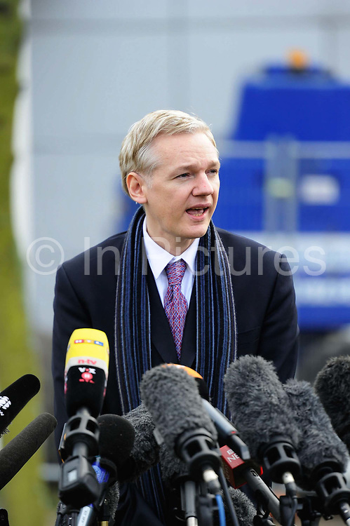 """WikiLeaks founder Julian Assange speaks after his extradition hearing at Belmarsh Magistrates' Court in London February 11, 2011. A lawyer for Assange accused Sweden's prime minister on Friday of damaging his client's chances of a fair trial for alleged sex crimes by portraying him as """"public enemy number one""""."""