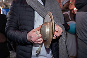 A man with hand cymbals celebrates during a Hare Krishna street dance on New Years Eve at Piccadilly on the 31st December 2019 in London in the United Kingdom.