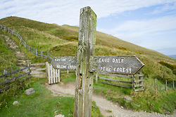 A wooden signpost for Mam Tor, Hollins Cross, Cave Dale and Peak Forrest at the foot of  Mam Tors Paved and Stepped West side<br />  11 October 2015<br />   Image © Paul David Drabble <br />   www.pauldaviddrabble.co.uk