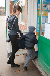 Teenage sister with  young brother entering primary school.