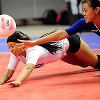 111612  Adron Gardner<br /> <br /> Laguna Acoma Hawk Raquel Aguino (3), left, and Jocelyn Riley (8) dive for a ball while playing the Hatch Valley Bears in the state volleyball quarterfinals at the Santa Ana Star Center in Rio Rancho Friday.