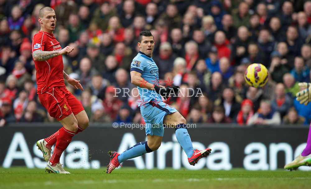 LIVERPOOL, ENGLAND - Sunday, March 1, 2015: Manchester City's Sergio Aguero sees his shot hit the Liverpool post during the Premier League match at Anfield. (Pic by David Rawcliffe/Propaganda)
