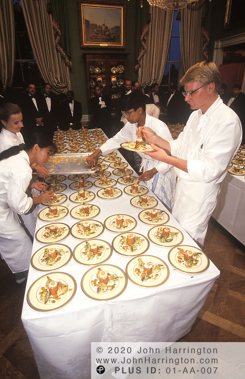 IN THE GREEN ROOM, CHEFS PUT THE FINAL TOUCHES ON THE FIRST COURSE OF A STATE DINNER AS THE BUTLERS AWAIT THE SIGNAL TO SERVE THE DISH TO WAITING GUESTS.